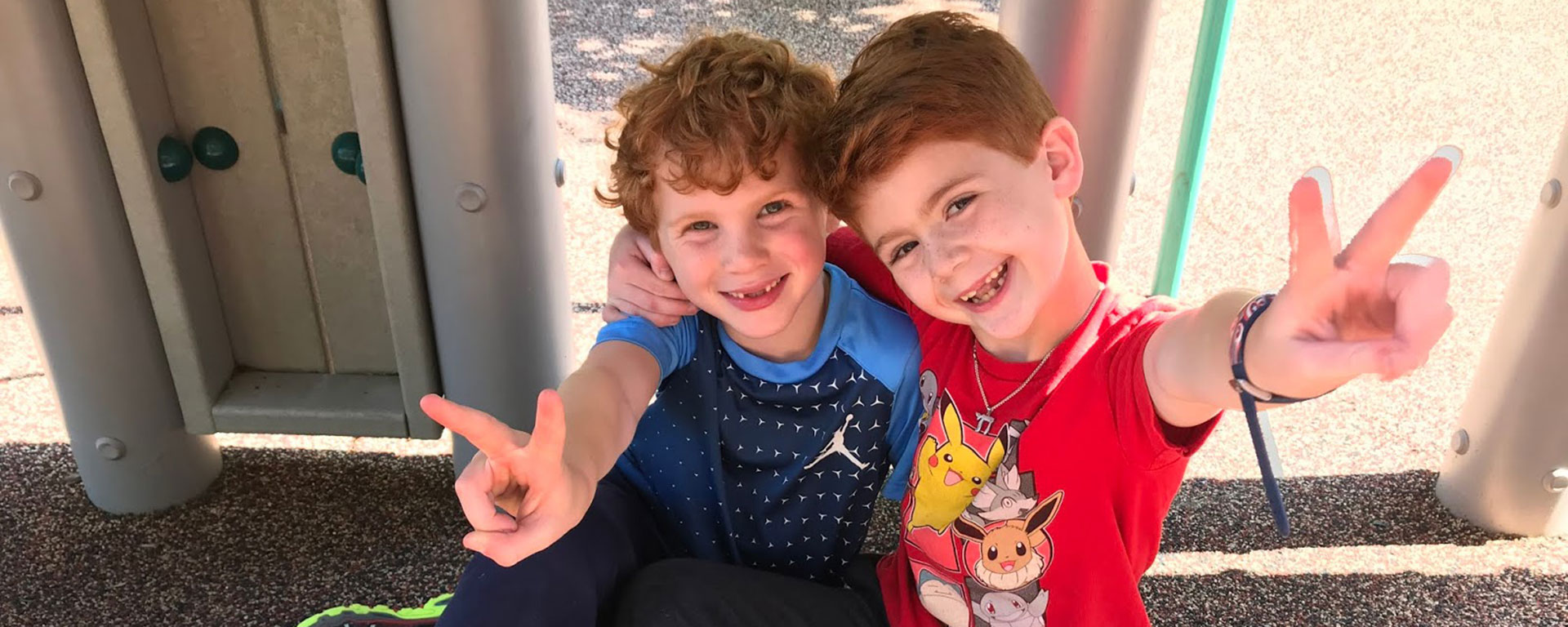 Two boys at recess showing a peace sign at The Rashi School, Reform Jewish K-8 Independent School
